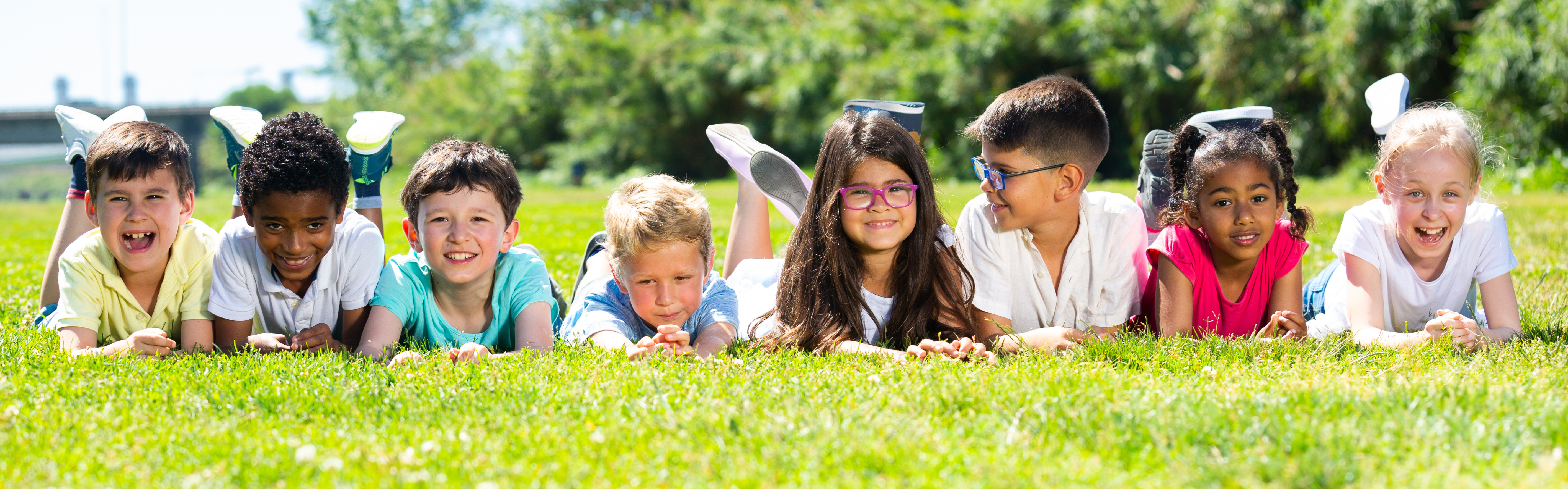 Kids laying in grass